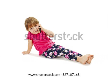 Happy baby girl talking on mobile. Isolated on white background - stock photo