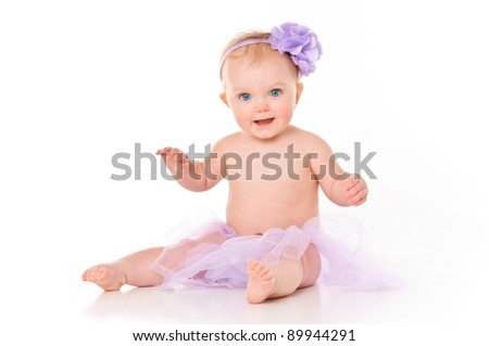 Happy Baby Girl wearing a Tutu and bow in her hair - stock photo
