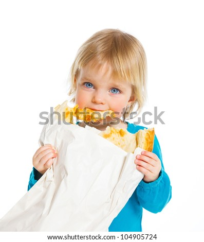 Happy baby girl with package of the bread, isolated on white.