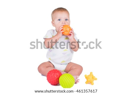Happy baby girl with Thai traditional dress playing with colorful ball on white isolate
