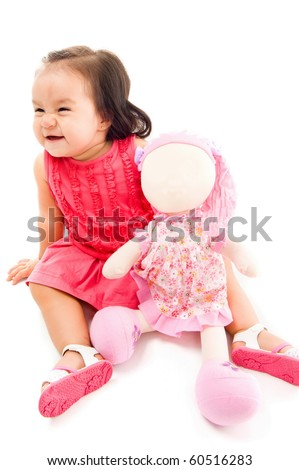Happy baby holding a doll on white background . - stock photo