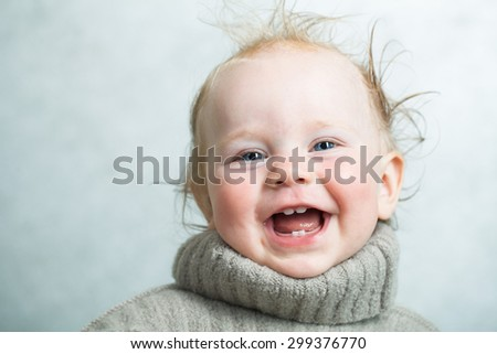 happy baby in a warm knitted sweater