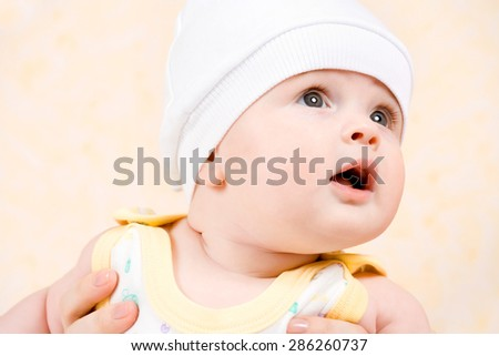 happy baby in a white hat