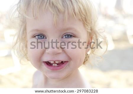 happy baby in the beach - stock photo
