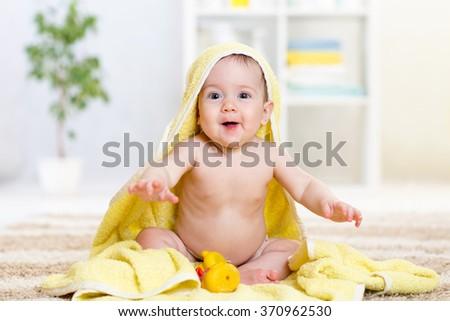 happy baby in towel indoor - stock photo