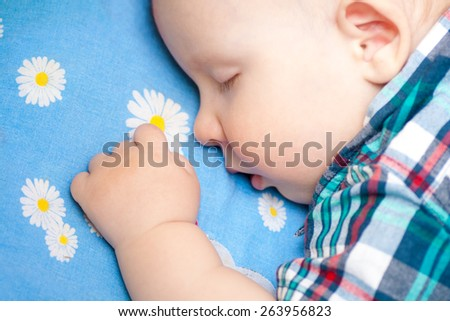 happy baby is sleeping, close-up
