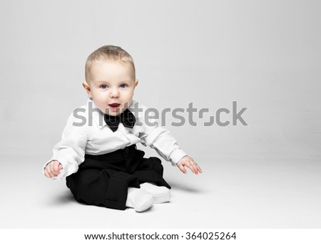Happy baby. Little boy in a white shirt and bow tie. Children portrait. Stylish man in fashionable a bow-tie. - stock photo