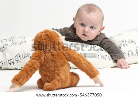 happy baby looking monkey plush