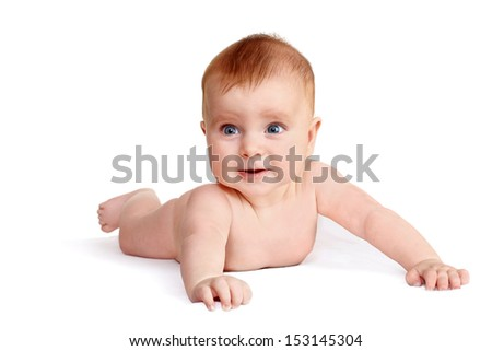 happy baby lying naked on her stomach