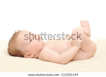 Happy baby lying on the bed.