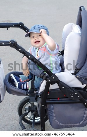 happy baby on baby buggy