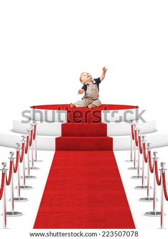 happy, baby on red carpet