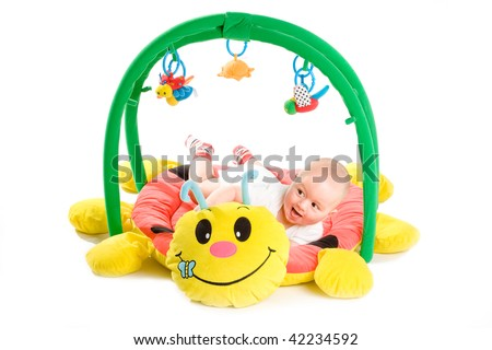 Happy baby playing in baby gym toy, isolated on white background. - stock photo