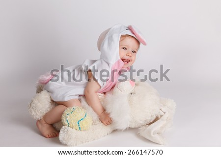 Happy baby playing in costume - stock photo