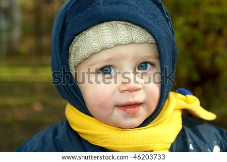 happy baby playing in park with leaves - stock photo