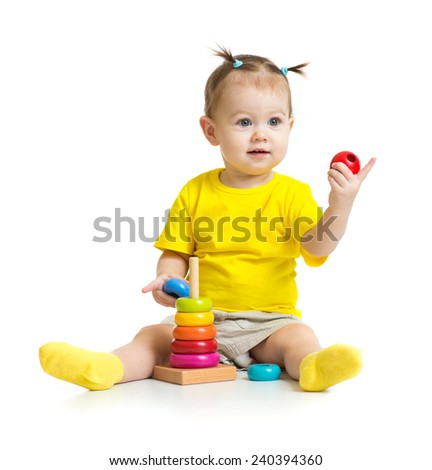 happy baby playing with colorful wood pyramid or tower isolated - stock photo