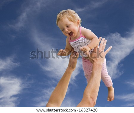 Happy baby playing with father - stock photo
