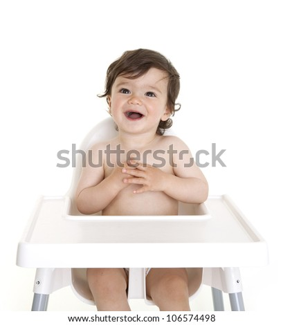 Happy baby sitting in highchair
