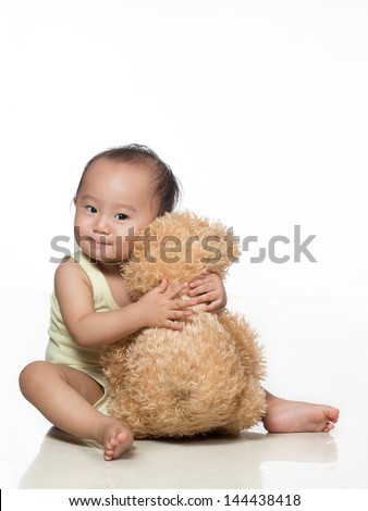 happy baby / toddler hugging stuffed toy animal - stock photo