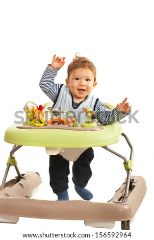 Happy baby walking in baby walker in his home