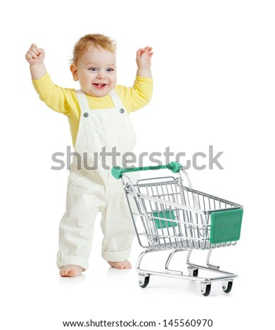 happy baby walking with shopping cart - stock photo