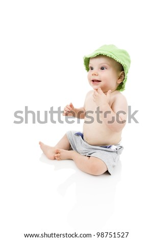 Happy baby wearing shorts and sun hat.