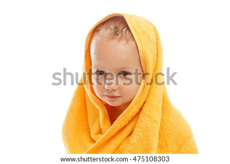 Happy baby wearing yellow towel sitting after bath or shower, isolated on white. Clean dry child in bedroom. Bathing and washing of little kids. Children hygiene. Textile for infants.