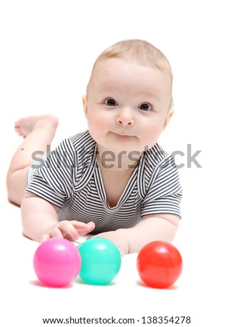 Happy baby with balls