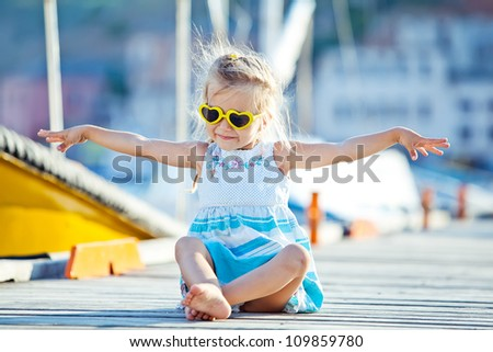 Happy baby with sunglasses from the sea