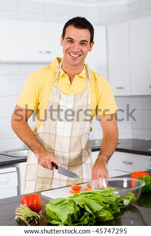 happy bachelor cooking in kitchen
