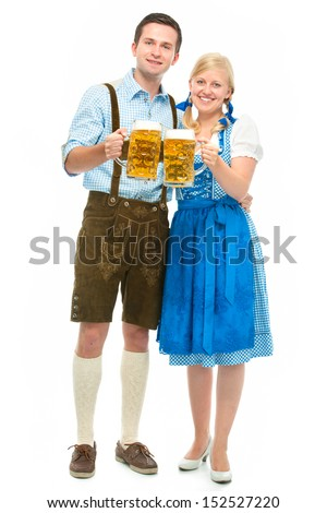 happy bavarian couple in dirndl with oktoberfest beer - stock photo