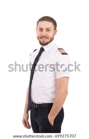 Happy beard pilot smiling and looking to you, guy wearing a pilot uniform, isolated on white background