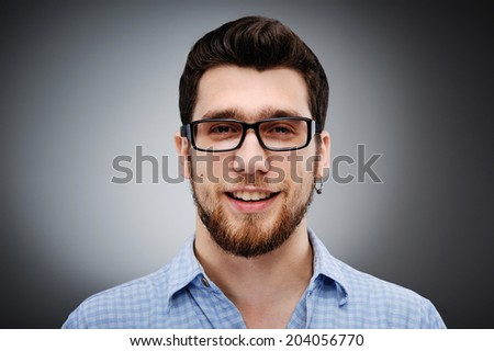 Happy bearded man with glasses