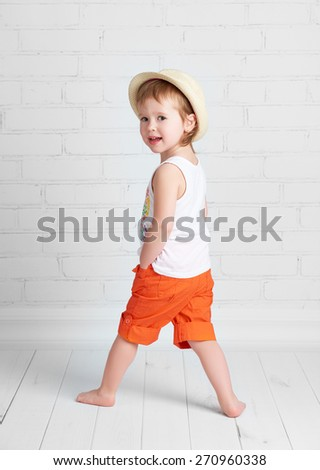 happy beautiful baby girl dancer dancing modern hip hop dance - stock photo