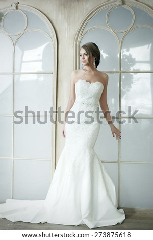 Happy Beautiful Bride Girl In Wedding White Dress. Glamour Hairstyle And Makeup. - stock photo