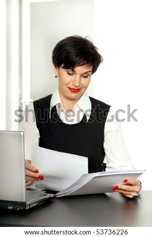Happy beautiful business woman at work