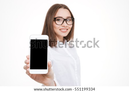 Happy beautiful business woman in eyeglasses showing blank smartphone screen isolated on a white background