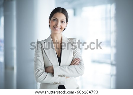 Happy Beautiful Business Woman in Office Hall