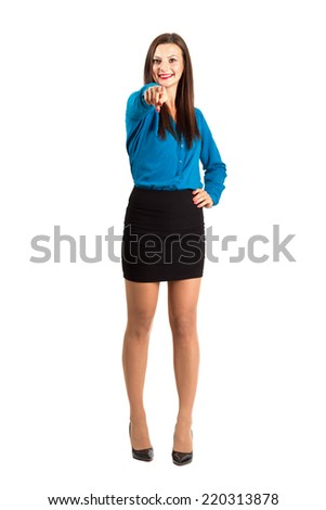 Happy beautiful business woman pointing finger at camera. Full body length isolated over white background. - stock photo