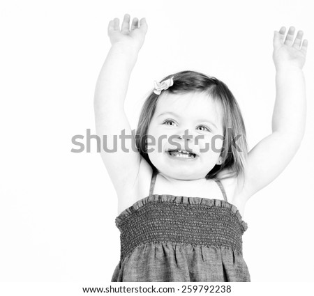 Happy beautiful child raising arms in air - stock photo