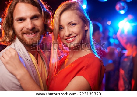 Happy beautiful couple embracing at party  - stock photo