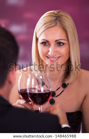 Happy Beautiful Couple Enjoying Meal And Wine In Restaurant - stock photo