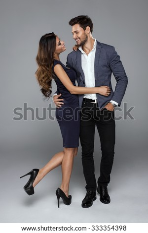 Happy beautiful couple looking at each other - stock photo