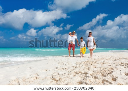 Happy beautiful family on a Caribbean holiday vacation - stock photo