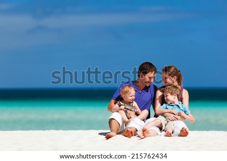 Happy beautiful family on a tropical beach during summer vacation