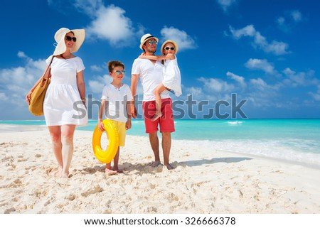 Happy beautiful family with kids on a tropical beach vacation - stock photo
