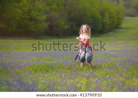 Happy beautiful  girl  running on grass field