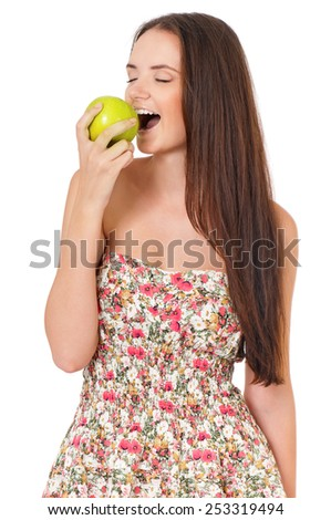 Happy beautiful girl with green apple, isolated on white background - stock photo
