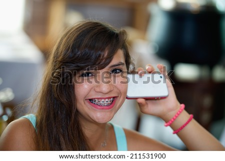 Happy beautiful girl with mobile phone - stock photo