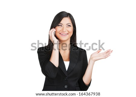 Happy beautiful Indian business woman talking by phone. Showing exited emotion while isolated on white  - stock photo
